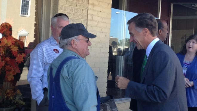 Tennessee Governor Bill Haslam shakes hands during his meet and greet session before he spoke in Brownsville Monday afternoon.