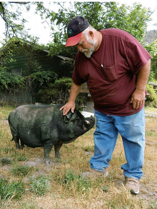 Mike Montoya and George, the rescue pot belly pig.