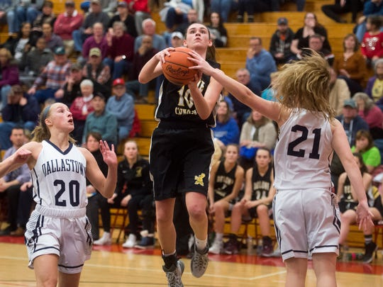 Delone Catholic's Maddie Clabaugh shoots the ball against Dallastown's Sabrina Stough (21) during Friday's YAIAA tournament quarterfinal. Delone Catholic won 45-44.