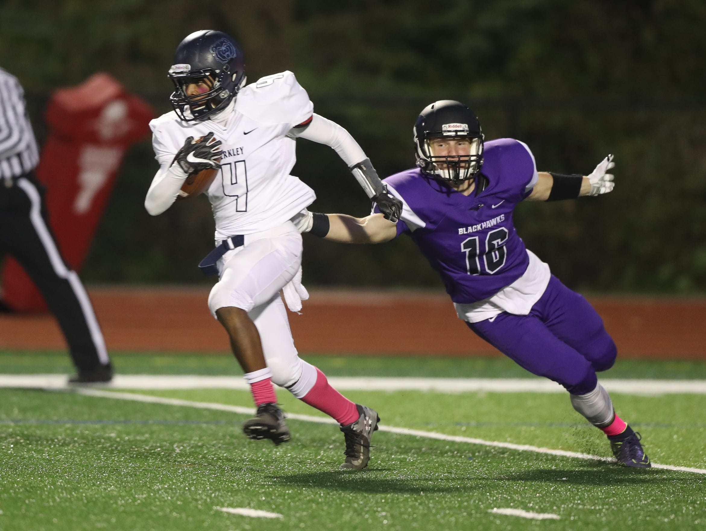 Bloomfield Hills' Marco Lozano tries to tackle a Berkley ballcarrier Friday at Bloomfield Hills.