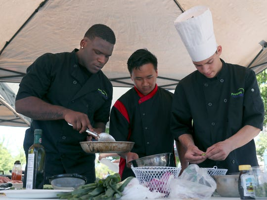 Team Enterprise members Victor Penn-Nash, from left, Brandon Fong and Justin Maynes prepare their winning dish during the high school Battle Chef competition Saturday.
