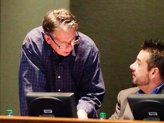 Mayor-President Joel Robideaux, left, speaks with Council