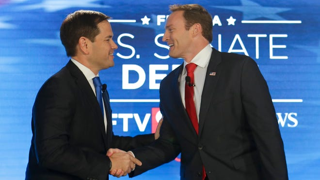 Sen. Marco Rubio, R-Fla., (left) and Rep. Patrick Murphy, D-Fla., shake hands before their debate Oct. 17, 2016 at the University of Central Florida in Orlando.