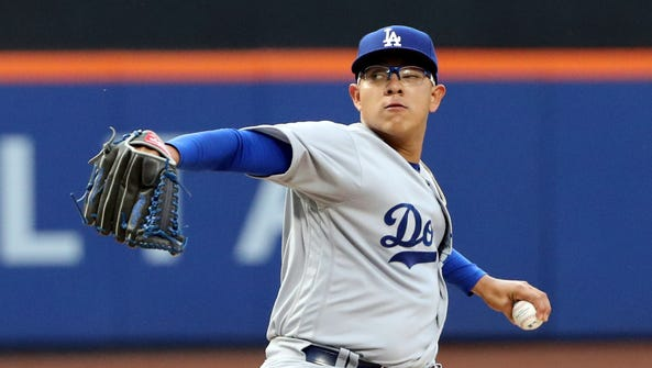 Julio Urias pitches during the first inning at Citi