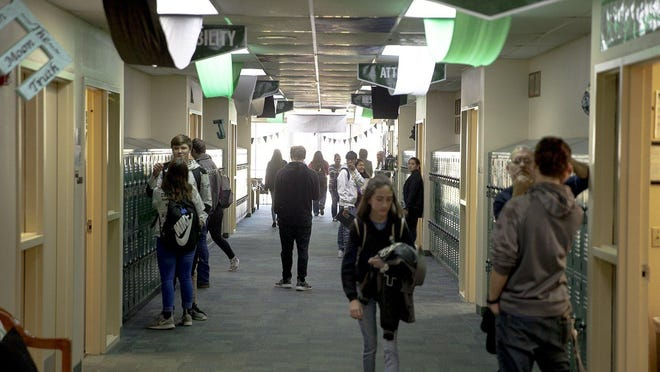 In this 2019 file photo, students walk the halls during a period change at Boles Independent School District near Quinlan.