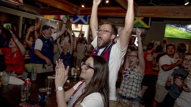 Christina Boman, left, and her husband Brian celebrate a goal by the United States during a FIFA Women's World Cup watch party at Haymaker last summer. Austin had the No. 1 television ratings for the tournament.