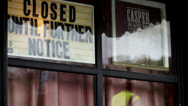 A sign hanging in a window of the Continental Club notifies customers of its temporary closure on March 17. The beloved South Congress music venue received $80,419.86 from two city coronavirus relief funds.