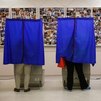 People cast their ballots in a polling station during the presidential primary election on April 26, 2016, in Philadelphia, Pa.