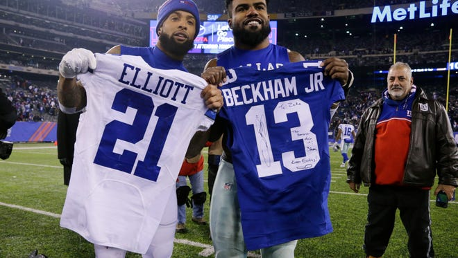 Giants' Odell Beckham, left, and Cowboys' Ezekiel Elliott exchanging jerseys after Sunday night's game at MetLife Stadium. Jersey swapping among NFL players has become a ritual around the league. (AP Photo/Seth Wenig)
