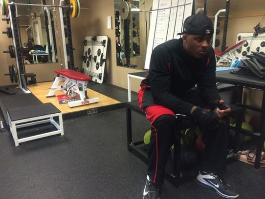 Free agent Jermichael Finley sits in the training room