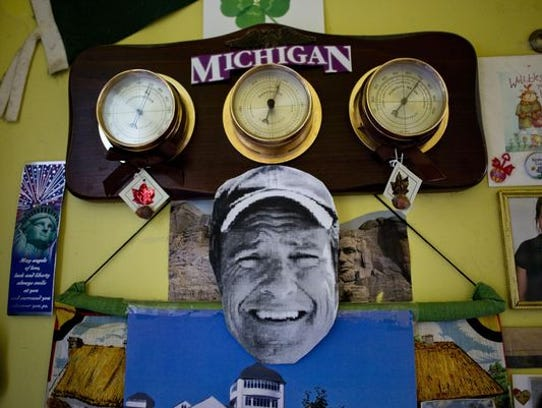 A cut-out photo of Mike Rowe hangs from a calendar