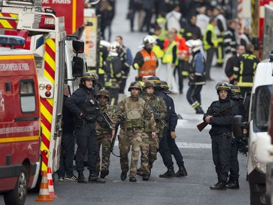 French soldiers and police are seen during a police