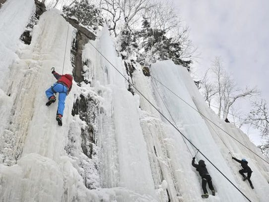 Climbers conquer frozen waterfalls at the Sandstone