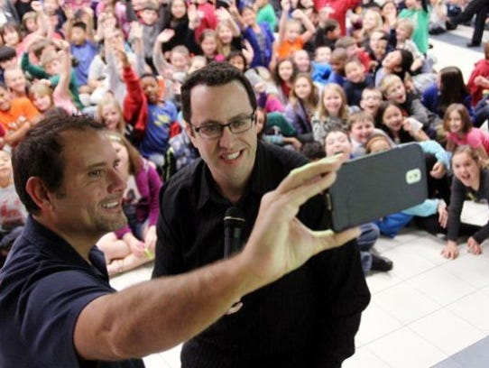 Russell Taylor and Jared Fogle at a school event in