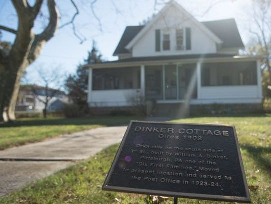"A marker showing the ""Dinker Cottage"" was once used"