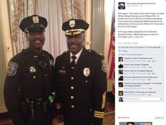 Officer Michael Spencer (left) is shown here in April