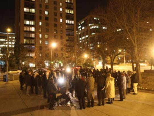 People gather outside the White Plains Public Safety