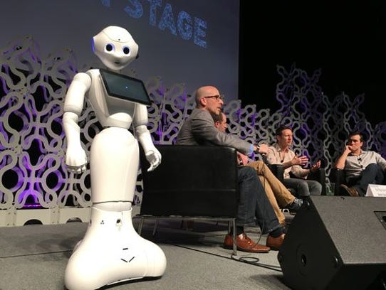 Pepper the robot looks on during a session about smart