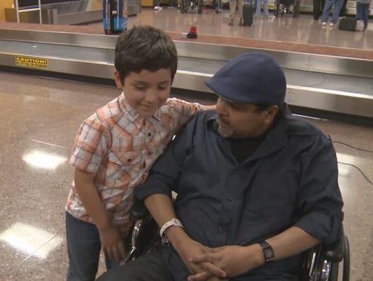 Jorge Alvarado talks with his son, Giovanni, at Phoenix-Mesa