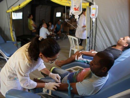 Patients receive treatment at a medical mobile unit