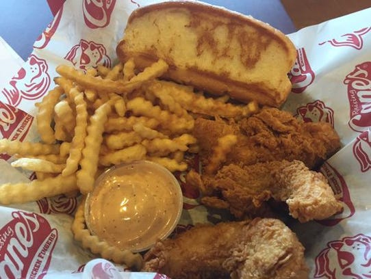 Raising Cane's chicken fingers, sauce, fries and toast