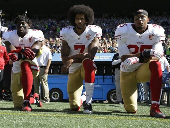 From left, San Francisco 49ers' Eli Harold, Colin Kaepernick