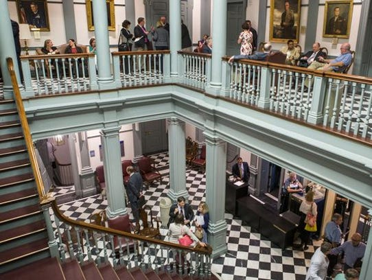 Visitors and lobbyists wait at Legislative Hall during the final day of the 2017 legislative calendar.