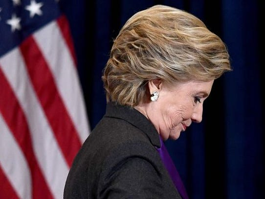 Hillary Clinton steps down a staircase after making