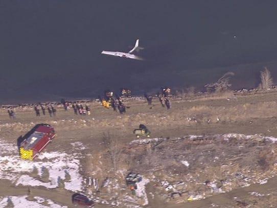 A Cessna 172 lies upside down in Culver Reservoir after