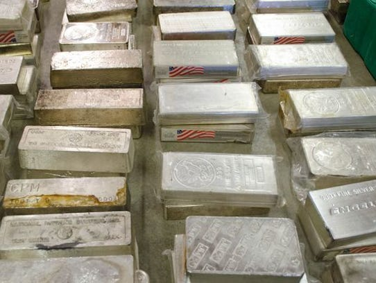 Local authorities seized 458 silver bars, along with