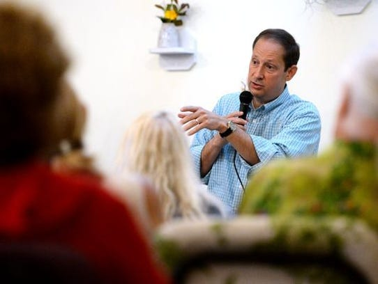 State Senate President Joe Negron answers questions