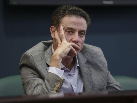 U of L basketball coach, Rick Pitino, looks on during