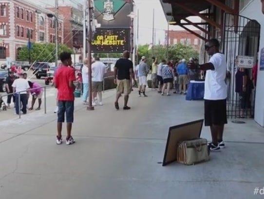 David Sadler stands outside the Biscuits' Riverwalk