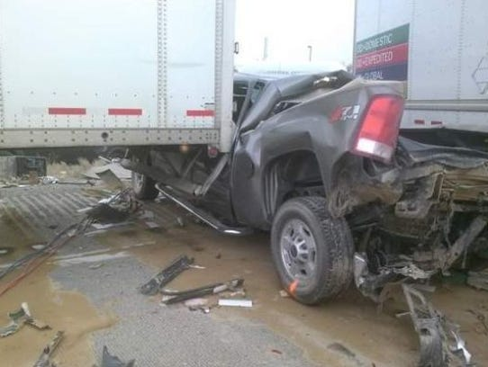 A pickup truck was crushed by semis during a huge wreck
