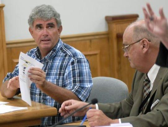 Scott Ellis, (right) the Brevard County Clerk of Courts
