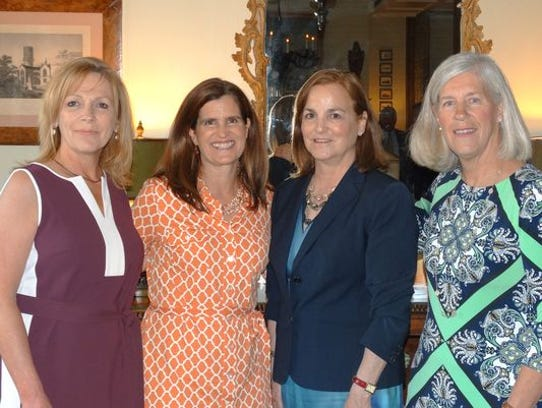 Coalition members meet with Mary Pat Christie at a
