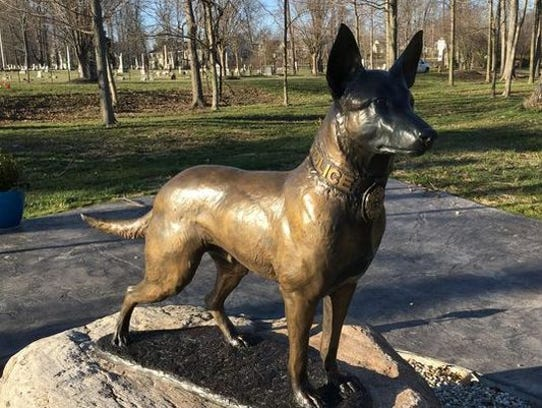 This bronze statue of a police dog keeps vigil at the