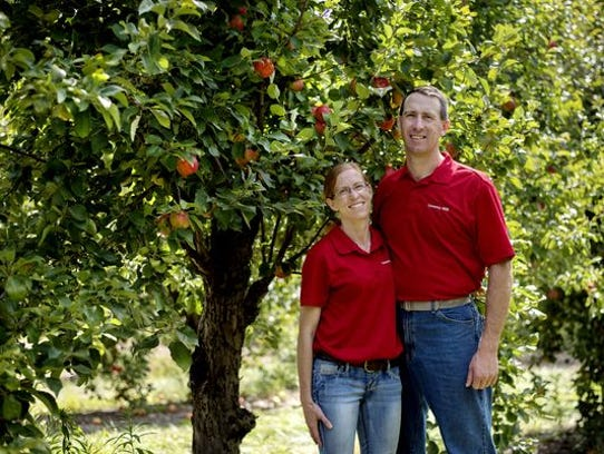 Country Mill owner Steve Tennes, right, and his wife