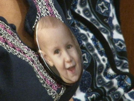 An image of toddler Mason Hess is displayed in court
