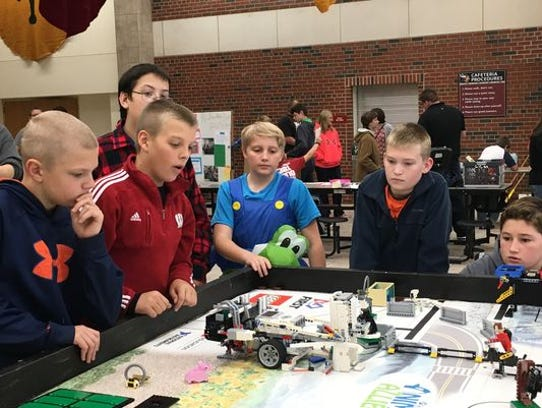 The Mishicot Middle School Robotics Team in action.
