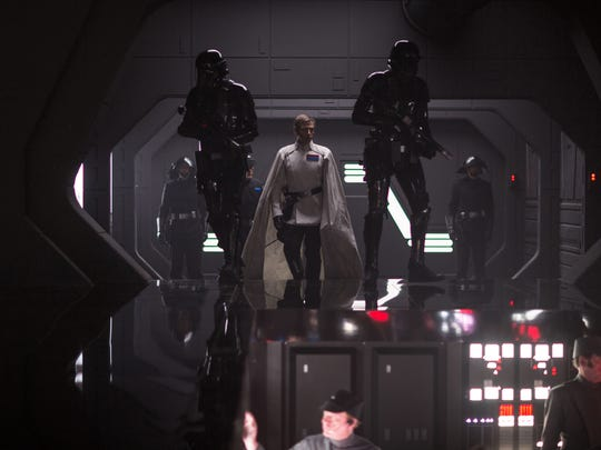 Director Krennic (Ben Mendelsohn, center) is flanked