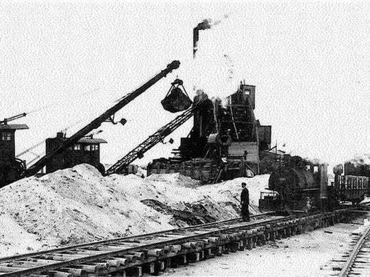 Large cranes were employed to scoop the sand off the beach along the surf line and place it into the boxcars that a small locomotive would pulled right up to the waterfront on the tracks.