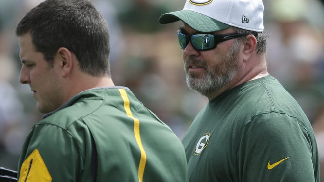 Green Bay Packers head coach Mike McCarthy (right) is shown during the team's organized team activities June 2.
