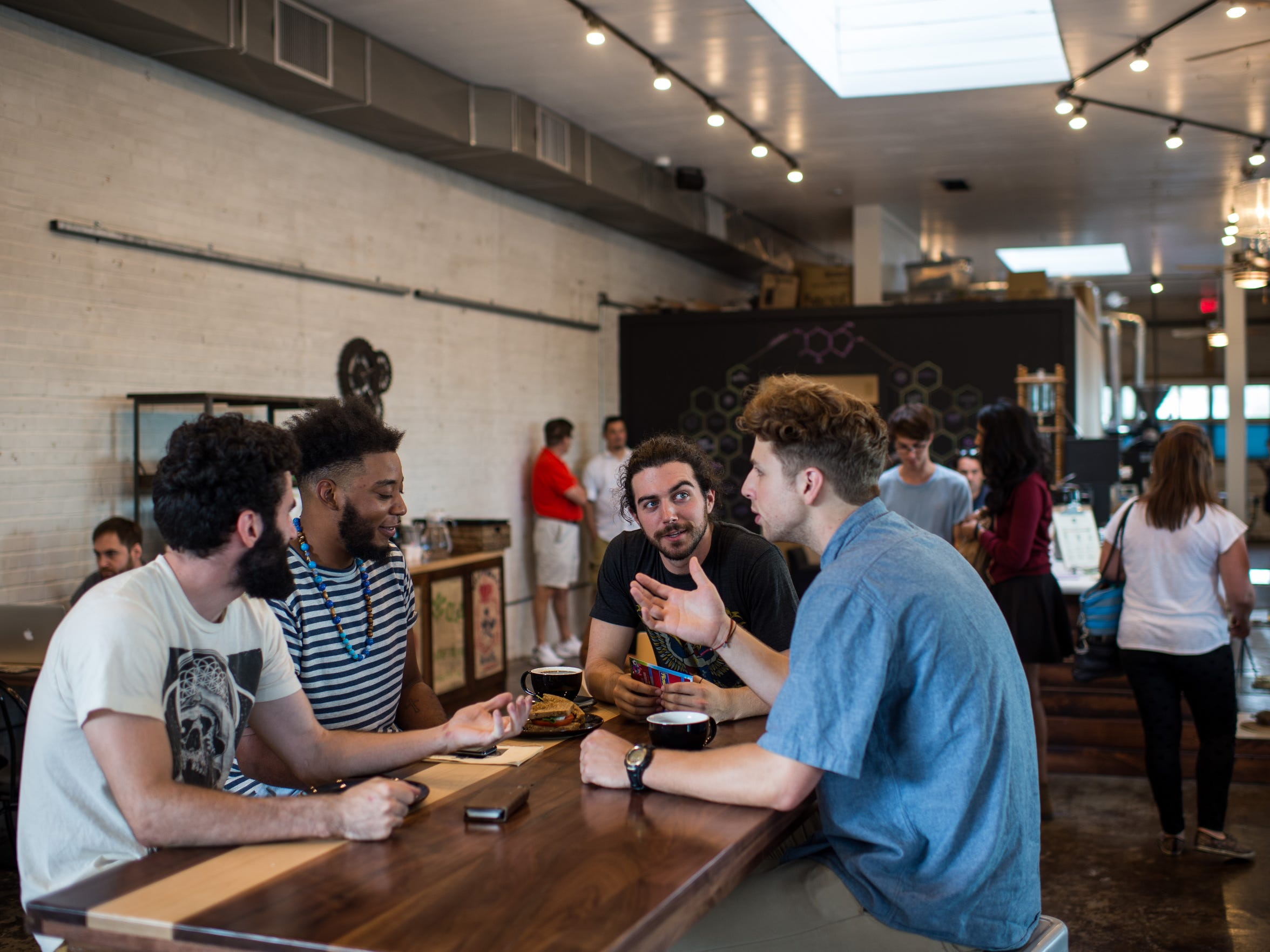 Customers converse at Reve Coffee Roasters in downtown Lafayette.