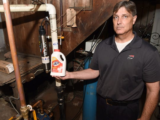 Don Rich stands near the UV system he and his wife use to kill the E. coli bacteria from the water in their private well at their home in the hamlet of Chelsea. They are currently fighting to be included on a new water main installed just short of their block. The water main is part of an ongoing project to repair an aqueduct used to bring water from the Catskills to New York City.