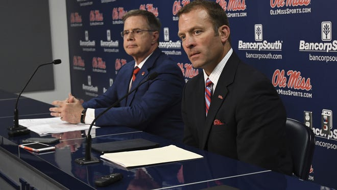 Ross Bjork (right), pictured with Jeff Vitter, Ole Miss chancellor, said the university began a review of its men's basketball program in wake of the FBI's probe into college hoops.