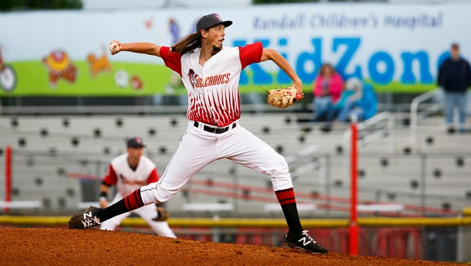 Volcanoes pitcher Stetson Woods pitches the Tri-City Dust Devils in the season opener on Thursday, June 15, 2017, at Volcanoes Stadium in Keizer, Ore.