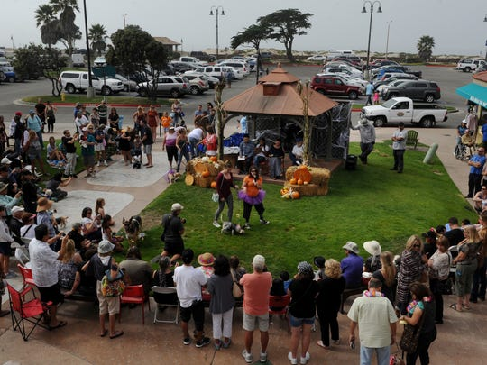 People attend the Howl-O-Ween costume contest for dressed-up