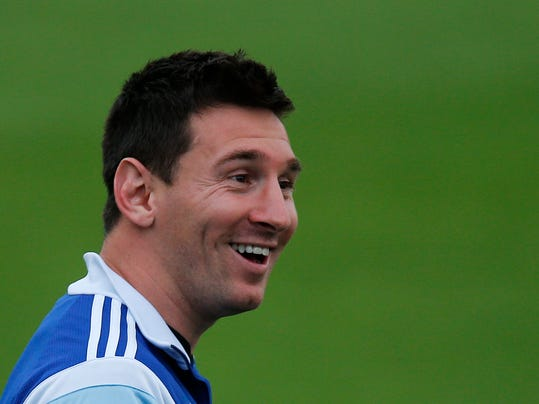 Argentina's Lionel Messi smiles during a training session in Vespesiano, near Belo Horizonte, Brazil, Wednesday, July 2, 2014. On Saturday, Argentina will face Belgium in their World Cup soccer match quarterfinal. (AP Photo/Victor R. Caivano)