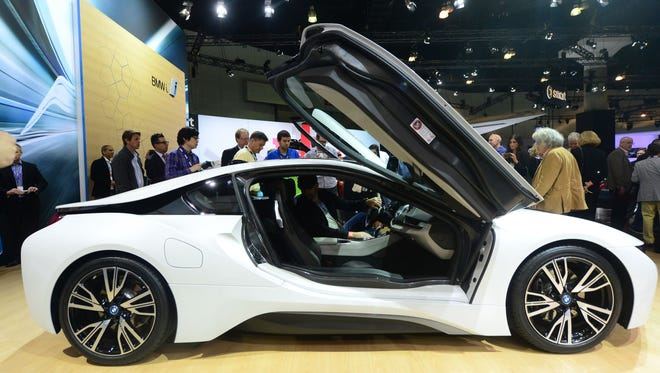 The BMW i8, due out next summer, attracts attention while displayed at the Los Angeles Auto Show